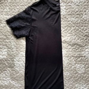 Prettylittlething black shirt sleeve lace top.